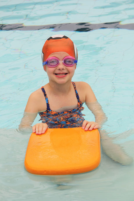 girl swimming kickboard
